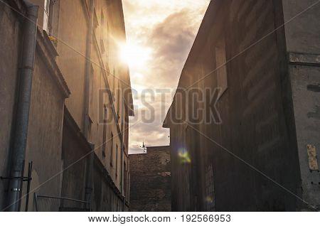 sunlight between tenement buildings in old town
