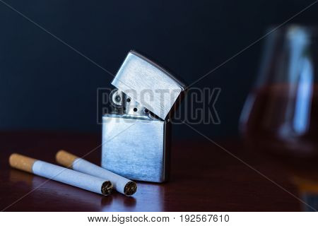 Cigarettes on the red table. Dark background.