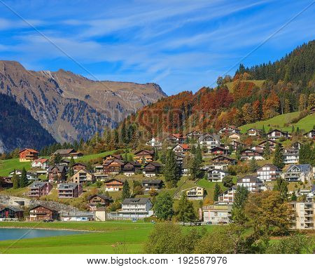 Engelberg, Switzerland - 12 October, 2015: buildings of the town of Engelberg as seen from the foot of Mt. Titlis. Engelberg is a resort town and municipality in the Swiss canton of Obwalden.