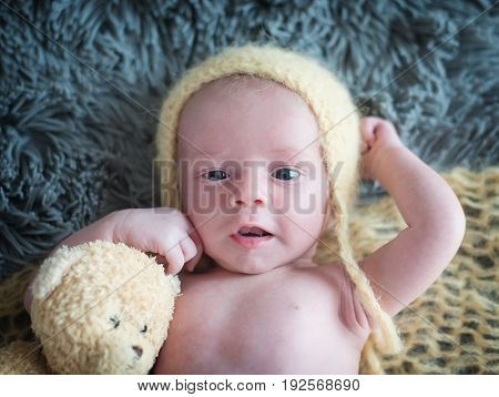 Cute newborn baby smiling looking at the camera
