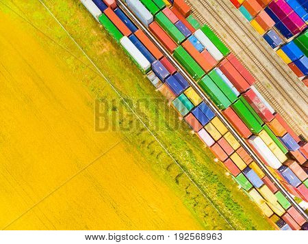 Aerial view of containers at railway. Industrial background. Industry from above. Environment and transportation.