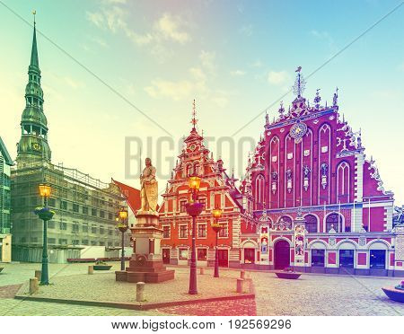 Hall town square with museum of House of Blackheads and Saint Peter church in Riga - capital city of Latvia, major cultural, historical and tourist center of Baltic region. Image toned for retro style