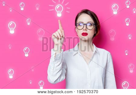 Puzzled Businesswoman With Abstract Lamps