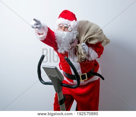 Santa Claus Have A Fun With Exercise Bikes