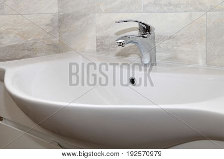 Bathroom interior with sink and chrome faucet. selective focus
