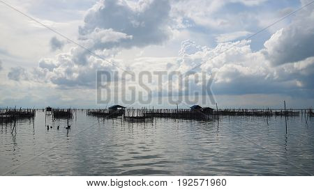 Homestay and floating basket in lake at Kohyo Songkhla Thailand with beautiful sky and clouds. This is traditional fisheries area.