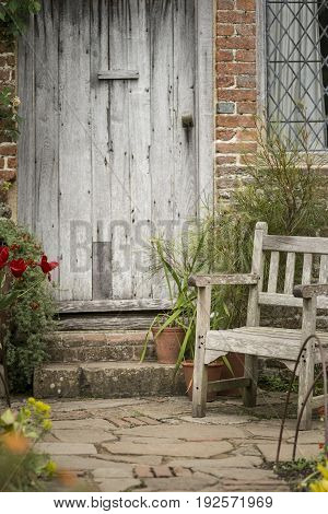 Typical Quintessential Old English Country Garden Image Of Wooden Chair Next To Vintage Back Door