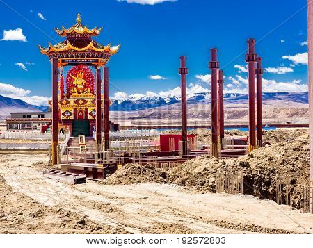 View of construction of statue in Yarchen Gar Monastery in Sichuan China