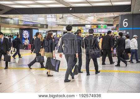 Tokyo, Japan - April 18, 2017: business people and white collar inside Shinjuku Station, the Tokyo's main station and the world's busiest transport hub with daily usage by up to 3.64 million people.