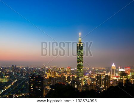 Taipei 101 skyscraper view and city skyline from elephant mountain with clear beautiful sunset sky at twilight night time