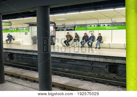 BARCELONA SPAIN - APRIL 19: People waiting on subway at station on April 19 2017 in Barcelona