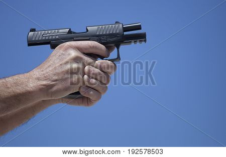 Handgun that is locked back after running out of ammo