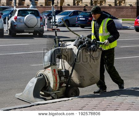 Voronezh, Russia - April, 27 2017: Cleaning the street with a manual sweeper
