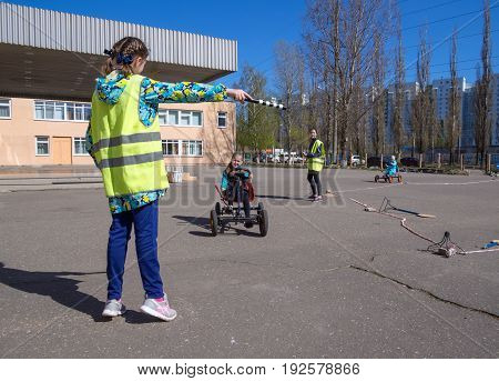 Voronezh, Russia - April 26, 2017: Teaching students the rules of the road in the game