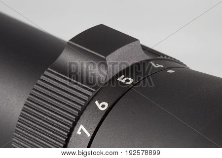 Dial that can be rotated on a rifle scope to adjust magnification