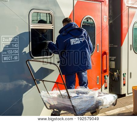 Voronezh, Russia - April 24, 2017: The courier brought the fresh press to the departure of the train