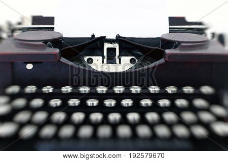 Blank paper in typewriter machine - detail
