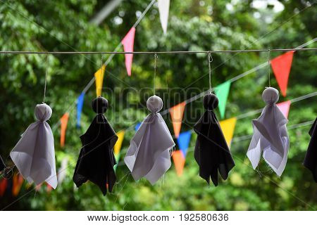 Chasing rain : Dolls for hanging at house to prevent raining.
