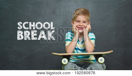 Boy With Skateboard And School Board With Text School Break
