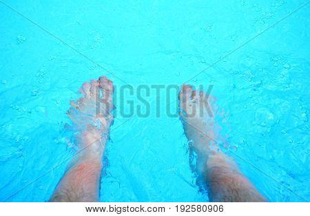 Refreshing Feet In A Pool