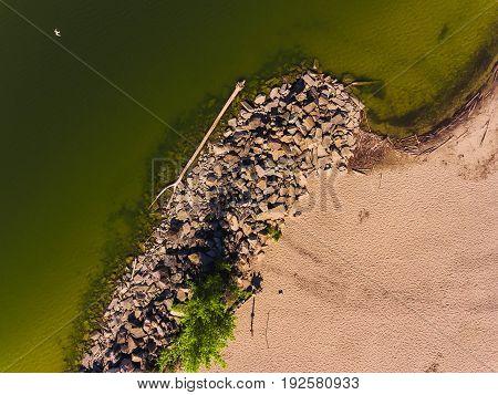 Aerial view of ocean beach. Sand beach and sea view from above. Beach aerial view of ocean water and sand shore. Aerial shot of beach