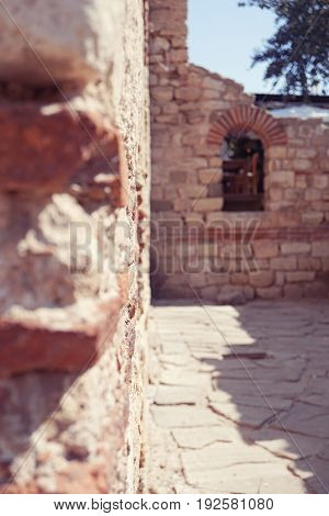 Historical ruins in the old town of Nessebar Bulgaria selective focus