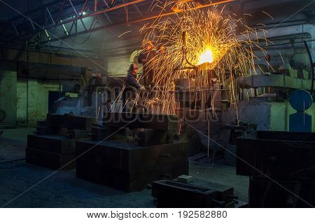 Metallurgical plant, hot metal casting and steelworkers