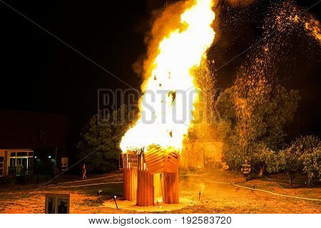 Saint Jean Festival In French Village. Flaming Sculpture Of Horse.