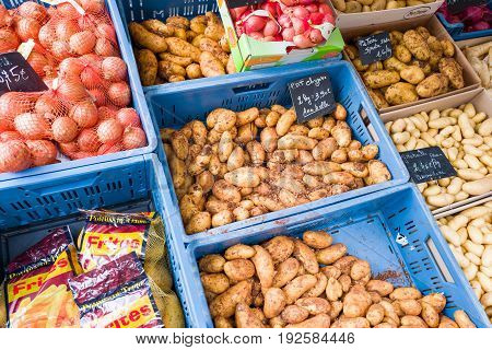 BELGIUM - BOMAL SUR OURTHE - JUNE 4 2017: Potatoes and onions on the sunday market at Bomal Sur Ourthe in Belgium.