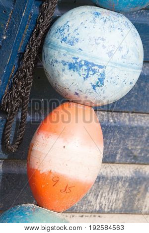Blue Buoy Hanging Out To Dry