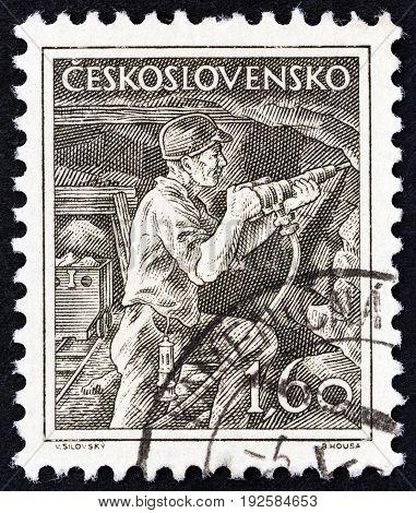 CZECHOSLOVAKIA - CIRCA 1954: A stamp printed in Czechoslovakia shows miner, circa 1954.