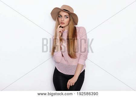 Cute And Stylish Beautiful Young Blonde Woman In Trendy Clothing Practicing Model Poses And Looking