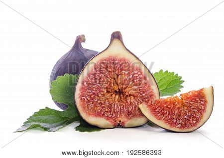 Ripe Figs With Leaves Over White