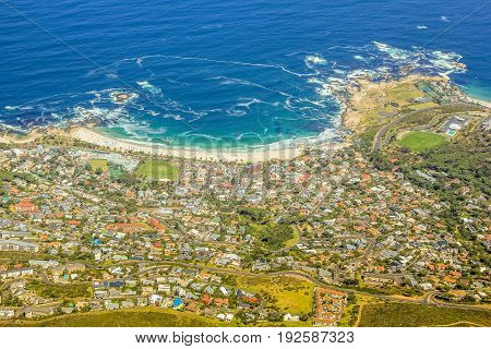 Aerial view of Camp's Bay Beach near Cape Town as seen from Lion's Head within the Table Mountain National Park in South Africa, Western Cape.