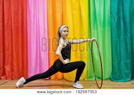 Flexible Young Woman In Sportswear Does Exercises With A Hoop