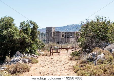 Ruins of the building of the British police station in Ein Tin at the beginning of the descent to the Amud River in Israel