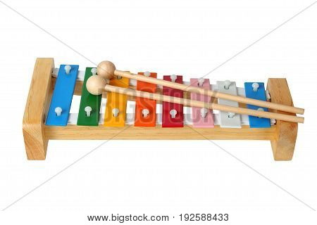 Rainbow xylophone with mallets on white background