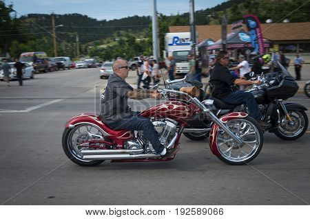 Sturgis South Dakota - August 8 2014: Rider in a street of the city of Sturgis in South Dakota USA during the annual Sturgis Motorcycle Rally