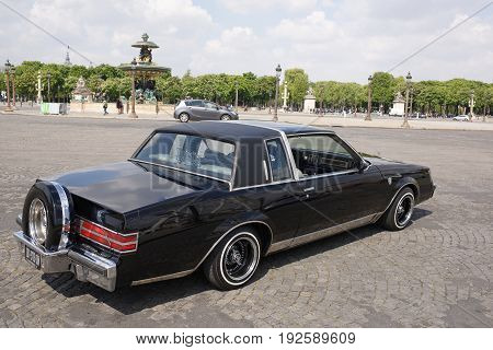 ParisFrance- April 29 2017: The car with the change of clearanceunder the control of the driver on the Place de la Concorde. Transport and pedestrians move along the square