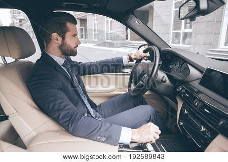 Young business person test drive new vehicle confident