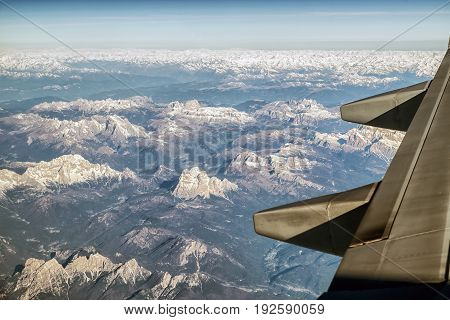 View from window of airplane on Alps mountains