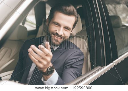 Young business person test drive new vehicle showing