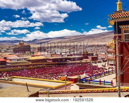 Sichuan, China - April 10 2017 : Unidentified tibetan buddhist monks and nuns gathered in Yarchen Gar Monastery in Sichuan, China, on April 10, 2017
