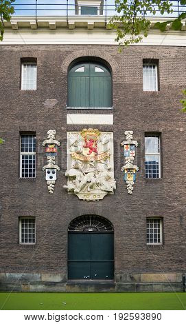 DELFT NETHERLANDS - SEPTEMBER 18 2016: Emblem on an old warehouse in the center of the city. The city is famous because of its association with the royal House of Orange-Nassau.