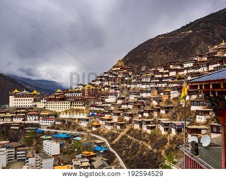View of Tibetan Town of Baiyu and the monastery in Sichuan China