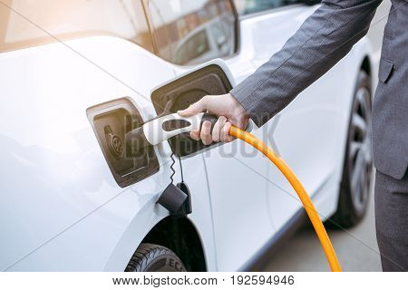 Man transportation by modern eco car charge energy
