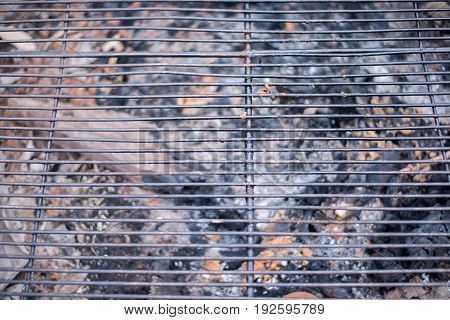 High Angle View Of A Barbecue Grill Grate.