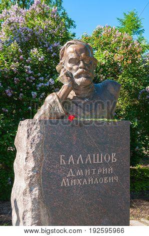 VELIKY NOVGOROD RUSSIA - JUNE 15 2017. Monument to Russian writer Dmitry Balashov in the park in summer sunny day in Veliky Novgorod Russia