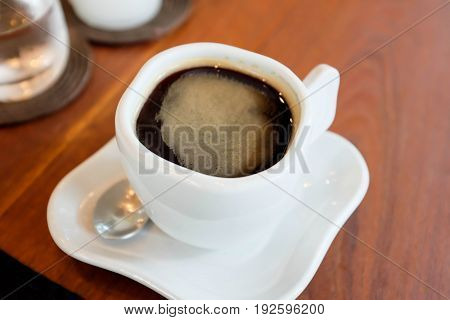 a cup of americano or hot coffee