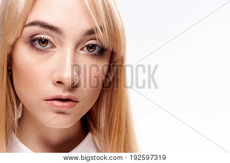 Portrait, blonde, woman on white isolated background, white shirt.